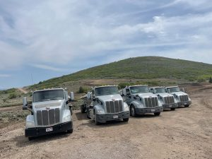 PETE 2015 DAY CAB TRUCKS AND 2017 AND 2018 TRAILKING TRIPLE AXLE SIDE DUMP SETS
